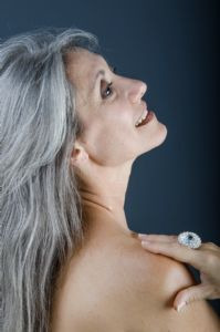 A colour portrait of grey hair model Valeria Sechi wearing a ring