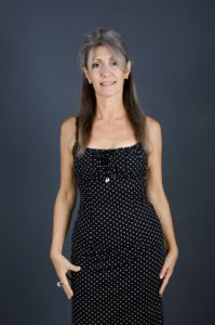A portrait of grey hair model Valeria Sechi with a pois dress