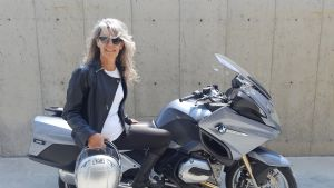 Grey hair model Valeria Sechi in jacket leather with a BMW R1200RT motorcycle