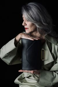 Grey hair model Valeria Sechi posing with a bag
