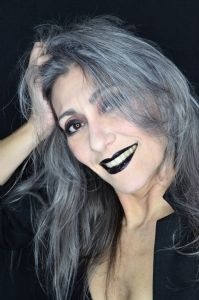 Grey hair model Valeria Sechi wearing a black jacket with dark lipstick