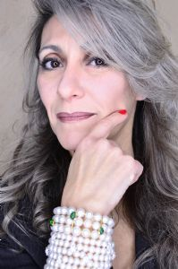 Grey hair model Valeria Sechi wearing a bracelet with pearls