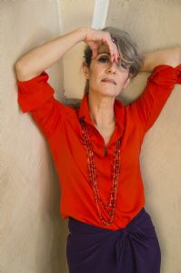 Grey hair model Valeria Sechi wearing a red fashion shirt