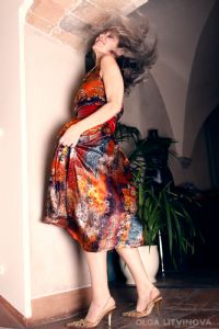 Grey hair model Valeria Sechi wearing fashion dress